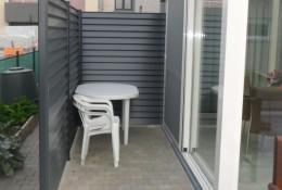 Cloture jardin en claustra aluminium aluclin gris.